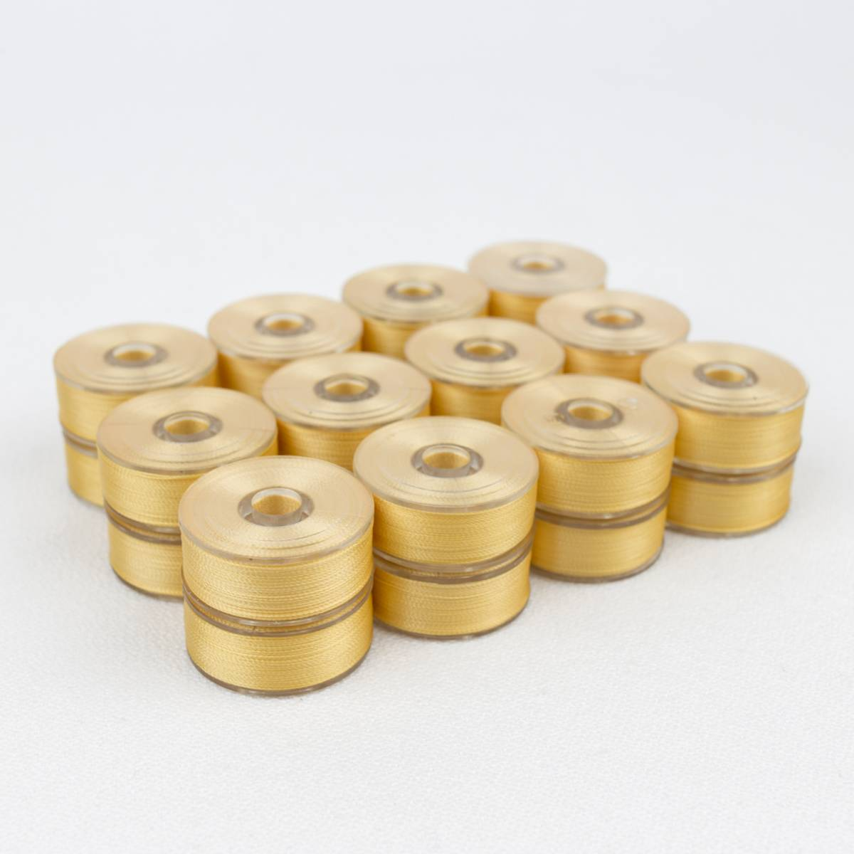 12stk ferdigspolet undertråd soft gold, DB138